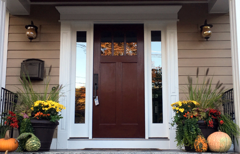 autumn door with shade containers